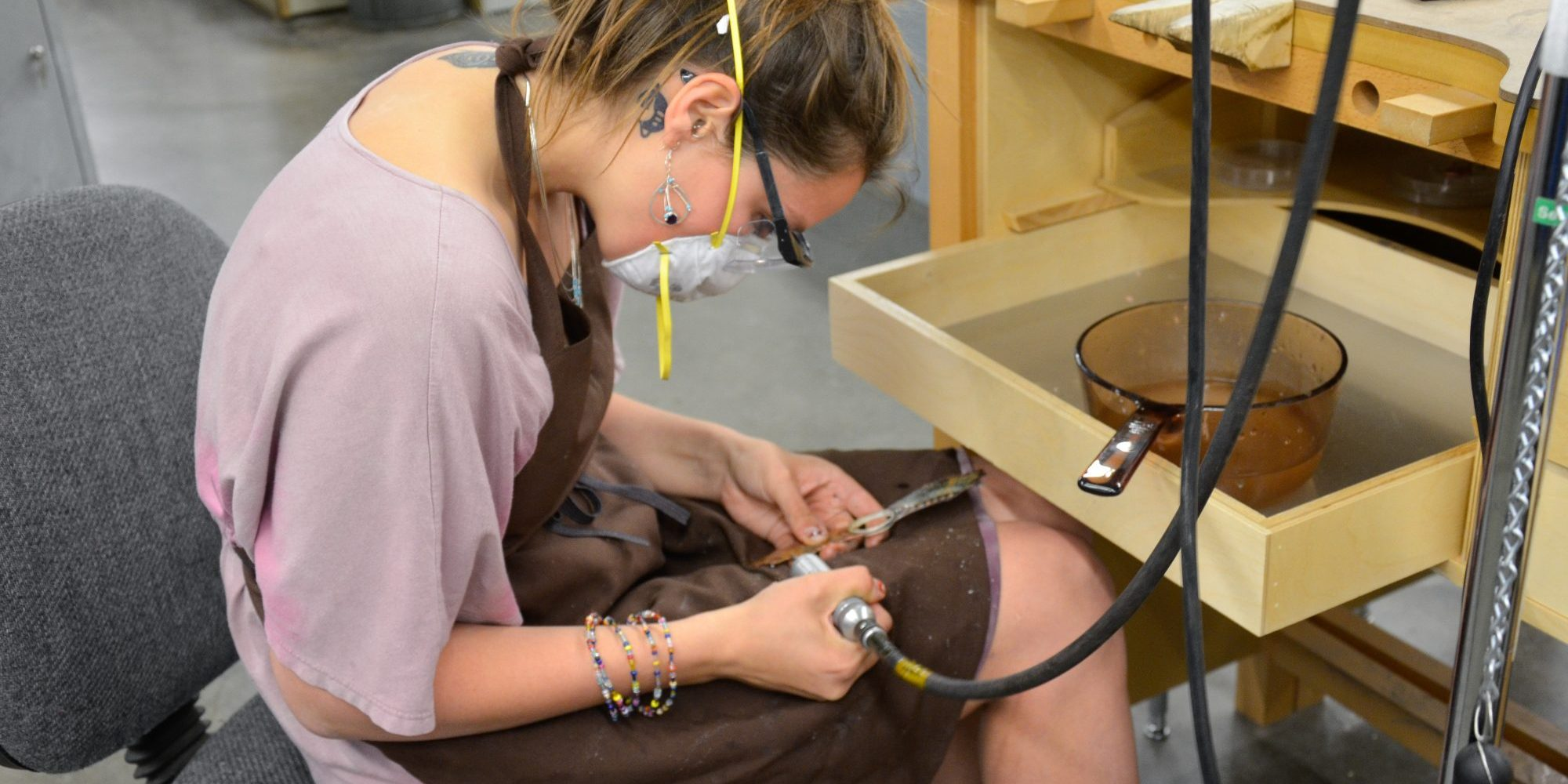 metalsmithing student working on project