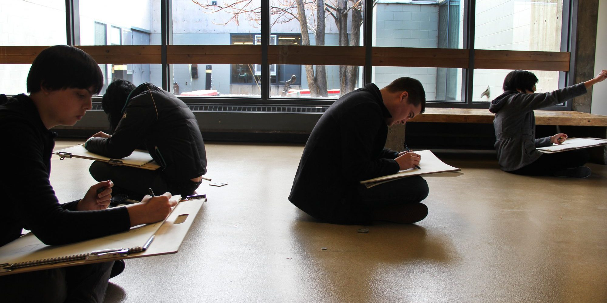 students drawing in hallway